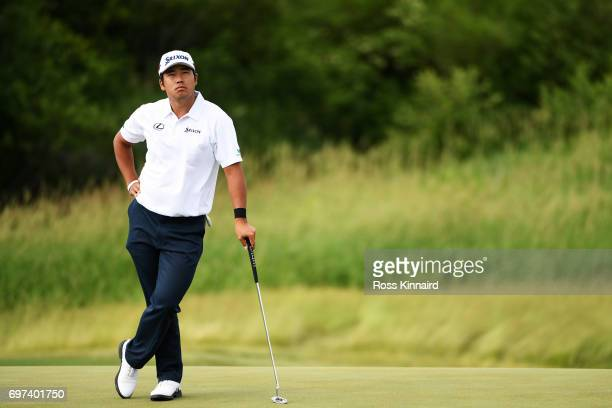 Hideki Matsuyama of Japan waits to putt on the 14th green during the final round of the 2017 US Open at Erin Hills on June 18 2017 in Hartford...