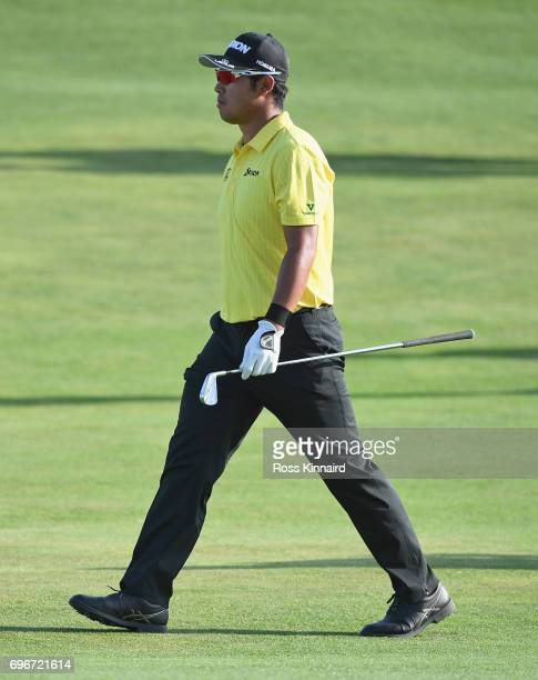 Hideki Matsuyama of Japan walks across the 18th hole during the second round of the 2017 U.S. Open at Erin Hills on June 16, 2017 in Hartford,...