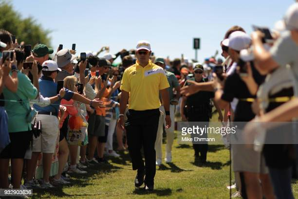 Hideki Matsuyama of Japan walks from the tee box during the second round at the Arnold Palmer Invitational Presented By MasterCard at Bay Hill Club...