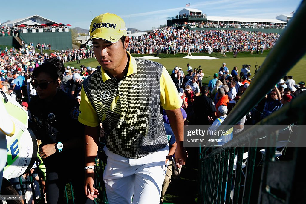Hideki Matsuyama of Japan walks off the 18th green following regulation during the final round of the Waste Management Phoenix Open at TPC Scottsdale on February 7, 2016 in Scottsdale, Arizona.