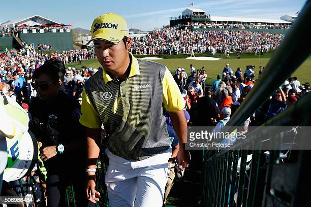 Hideki Matsuyama of Japan walks off the 18th green following regulation during the final round of the Waste Management Phoenix Open at TPC Scottsdale...