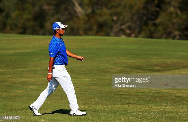 Hideki Matsuyama of Japan walks pn the fourth hole during the final round of the Hyundai Tournament of Champions at Plantation Course at Kapalua Golf...