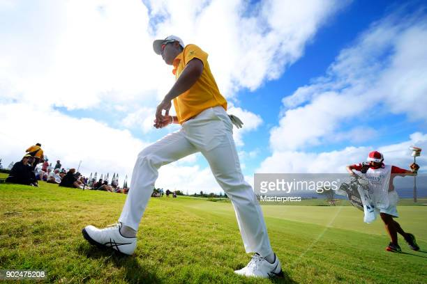 Hideki Matsuyama of Japan walks to the 14th hole during the final round of the Sentry Tournament of Champions at Plantation Course at Kapalua Golf...