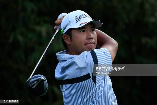 Hideki Matsuyama of Japan watches his drive on the 11th hole during the first round of The PLAYERS Championship on The Stadium Course at TPC Sawgrass...