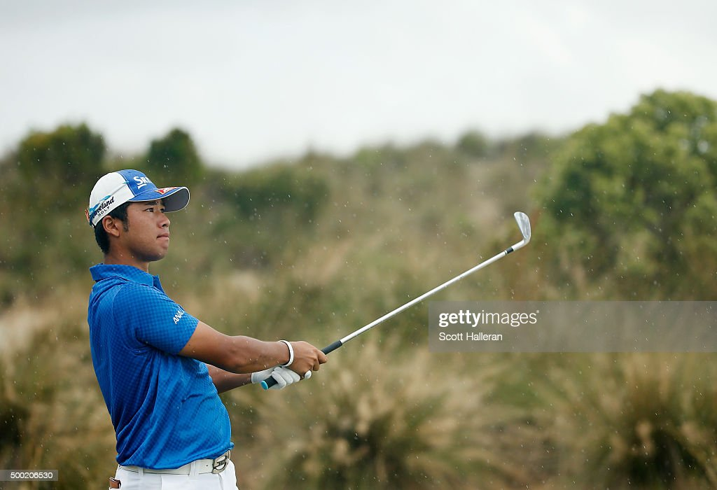 Hideki Matsuyama of Japan watches his tee shot on the second hole during the final round of the Hero World Challenge at Albany, The Bahamas on December 6, 2015 in Nassau, Bahamas