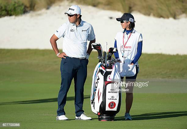 Hideki Matsuyama of Japan watches play on the 16th fairway during the final round of the Hero World Challenge at Albany course on December 4 2016 in...