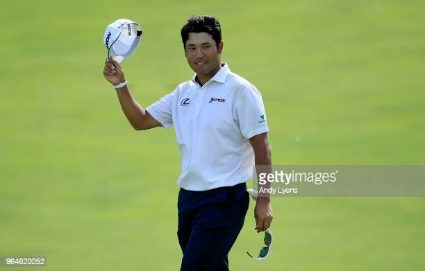 Hideki Matsuyama of Japan waves to the gallery after making an eagle on the 17th hole during the first round of The Memorial Tournament Presented by...