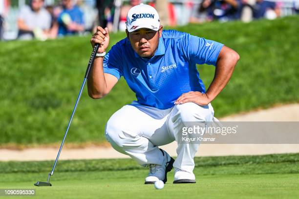 Hideki Matsuyama reads his putt on the 13th hole green during the final round of the Farmers Insurance Open on Torrey Pines South on January 27 2019...