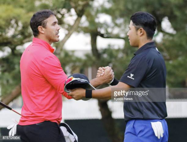 Hideki Matsuyama shakes hands with Brooks Koepka after finishing the third round of the Dunlop Phoenix on Nov 18 in Miyazaki Prefecture ==Kyodo