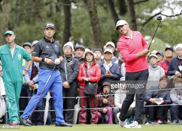 Hideki Matsuyama watches Brooks Koepka tee off on the second hole during the third round of the Dunlop Phoenix on Nov 18 in Miyazaki Prefecture...