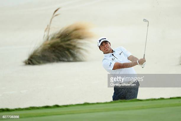 Hideki Matusyama of Japan hits a shot from a greenside bunker on the third hole during the final round of the Hero World Challenge at Albany The...