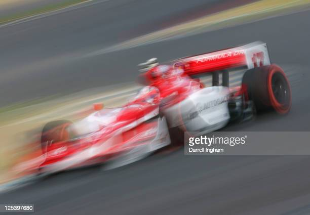 Hideki Mutoh drives the SSM Sam Schmidt Motorsport Dallara Honda during practice for the Indy Japan 300 The Final on the road course at the Twin Ring...
