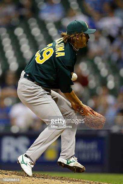Hideki Okajima of the Oakland Athletics gets hit by a this ball from Ryan Braun of the Milwaukee Brewers in the bottom of the eighth inning during...