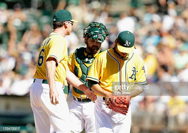 Hideki Okajima of the Oakland Athletics is taken out of the game by manager Bob Melvin during their game against the New York Yankees at Oco Coliseum...