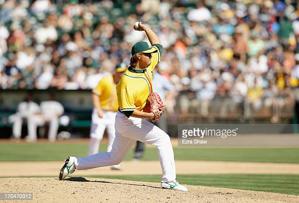 Hideki Okajima of the Oakland Athletics pitches against the New York Yankees at Oco Coliseum on June 13 2013 in Oakland California