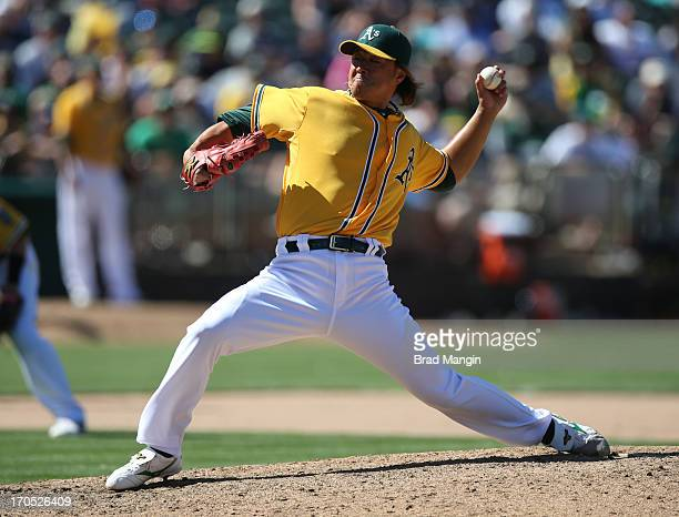 Hideki Okajima of the Oakland Athletics pitches against the New York Yankees during the game at Oco Coliseum on Thursday June 13 2013 in Oakland...