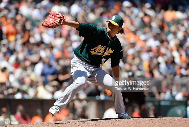 Hideki Okajima of the Oakland Athletics pitches against the San Francisco Giants in the six inning at ATT Park on May 30 2013 in San Francisco...