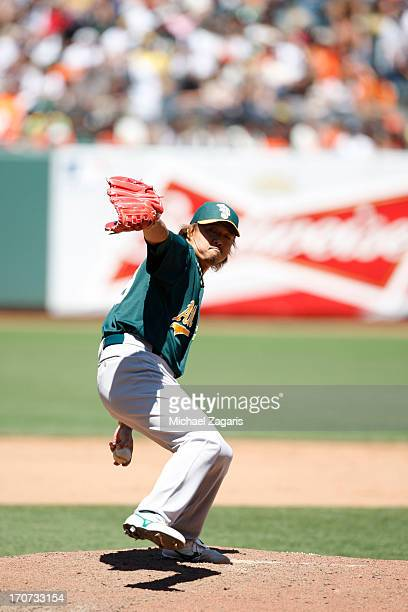 Hideki Okajima of the Oakland Athletics pitches during the game against the San Francisco Giants at ATT Park on May 30 2013 in San Francisco...