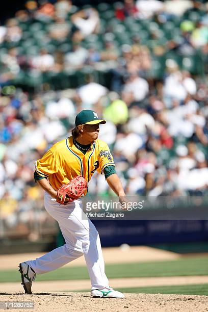 Hideki Okajima of the Oakland Athletics pitches during the game against the New York Yankees at Oco Coliseum on June 13 2013 in Oakland California...