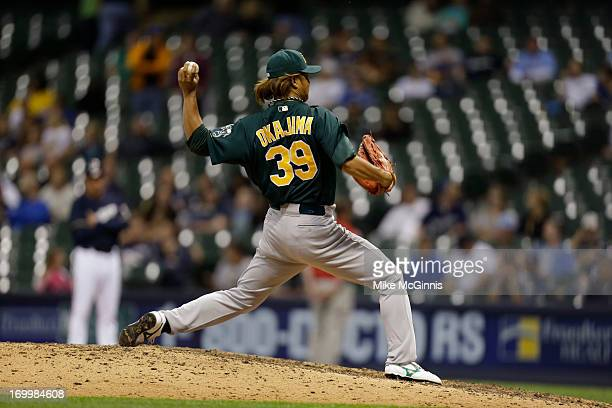 Hideki Okajima of the Oakland Athletics pitches in the bottom of the eighth inning against the Milwaukee Brewers during the interleague game at...