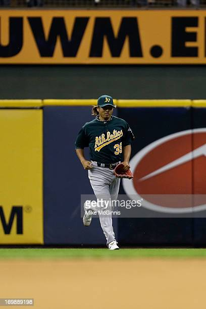 Hideki Okajima of the Oakland Athletics takes to the field in the bottom of the eighth inning against the Milwaukee Brewers during the interleague...