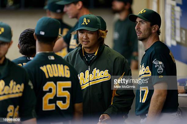 Hideki Okajima of the Oakland Athletics walks the dugout before the interleague game against the Milwaukee Brewers at Miller Park on June 03 2013 in...