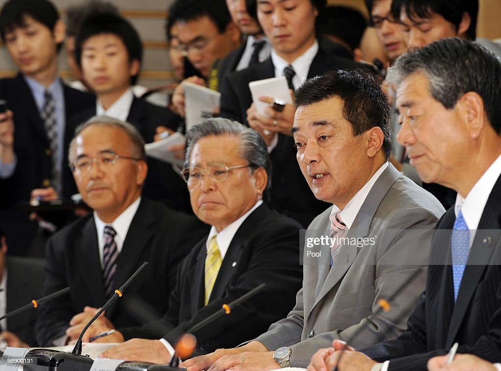 Hideki Takaoka, Mayor of Tokunoshima town (2nd R) delivers a message to Japanese Prime Minister Yukio Hatoyama (not in photo) during a meeting with Tokunoshima island mayors incluing Takaoka Kosuke Ohisa of Amagi town (2nd L) and Akira Okubo of Isen town (L) over plans to relocate some military operations at Hatoyama's official residence on May 7, 2010 in Tokyo, Japan.