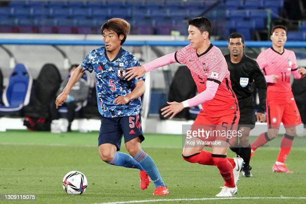 Hidemasa Morita of Japan and Woo-young Jung of korea compete for the ball during the international friendly match between Japan and South Korea at...