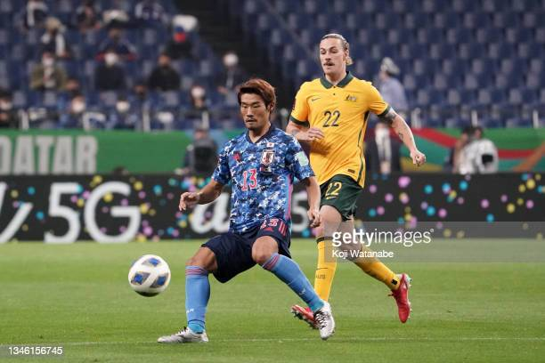 Hidemasa Morita of Japan controls the ball under pressure of Jackson Irvine of Australia during the FIFA World Cup Asian qualifier final round Group...