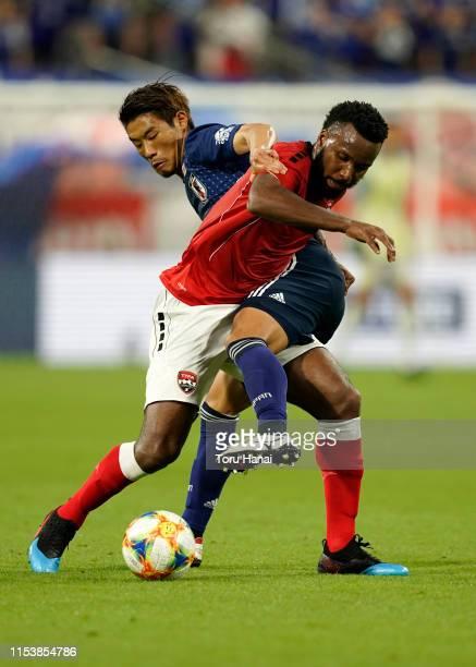 Hidemasa Morita of Japan in action against Khaleem Hyland of Trinidad and Tobago during the international friendly match between Japan and Trinidad...
