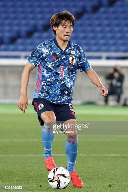 Hidemasa Morita of Japan in action during the international friendly match between Japan and South Korea at the Nissan Stadium on March 25, 2021 in...