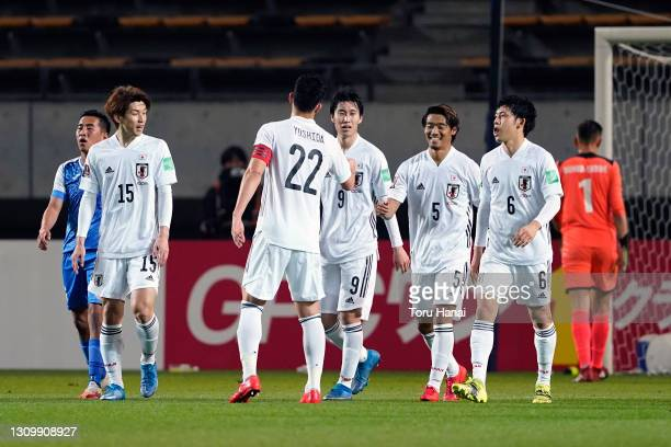 Hidemasa Morita of Japan scores his side's fourth goal with his team mates during the FIFA World Cup Asian Qualifier second round between Mongolia...