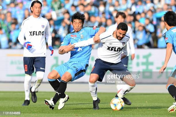 Hidemasa Morita of Kawasaki Frontale and Diego Oliveira of FC Tokyo compete for the ball during the J.League J1 match between Kawasaki Frontale and...