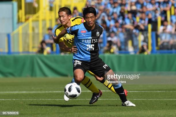 Hidemasa Morita of Kawasaki Frontale and Kei Koizumi of Kashiwa Reysol compete for the ball during the JLeague J1 match between Kashiwa Reysol and...