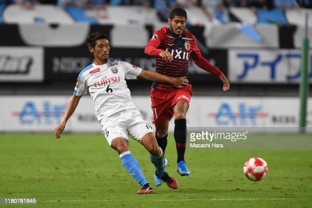 Hidemasa Morita of Kawasaki Frontale and Leandro of Kashima Antlers compete for the ball during the J.League Levain Cup semi final second leg match...