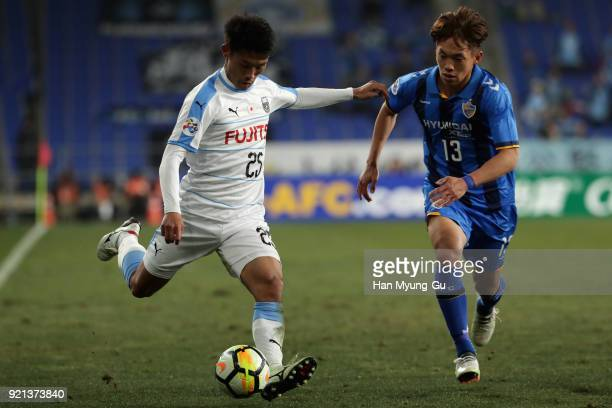 Hidemasa Morita of Kawasaki Frontale and Lee Myungjae of Ulsan Hyndai compete for the ball during the AFC Champions League Group F match between...