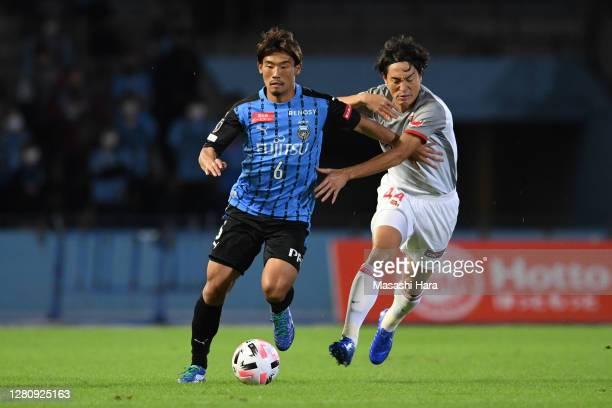 Hidemasa Morita of Kawasaki Frontale and Mu Kanazaki of Nagoya Grampus compete for the ball during the J.League Meiji Yasuda J1 match between...