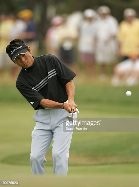Hidemichi Tanaka of Japan hits a pitch shot on the fourth hole during the third round of the 104th U.S. Open at Shinnecock Hills Golf Club June 19,...