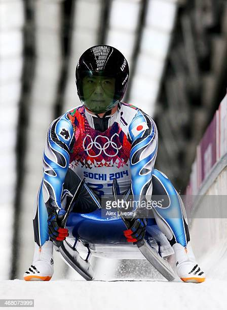 Hidenari Kanayama of Japan reacts after competing the 3rd run during the Men's Luge Singles on Day 2 of the Sochi 2014 Winter Olympics at Sliding...