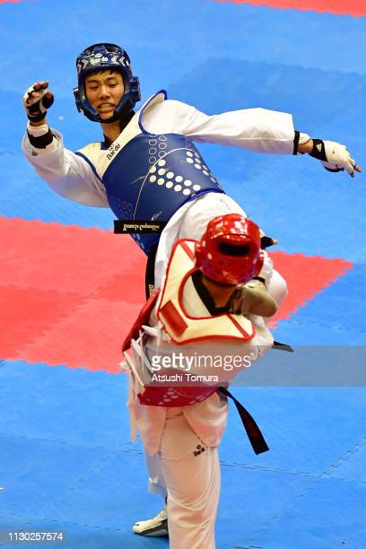 Hidenori Ebata and Issei Hamada of Japan compete during the Kyorugi event during day two of the Japan Taekwondo Championships at Chiba Port Arena on...