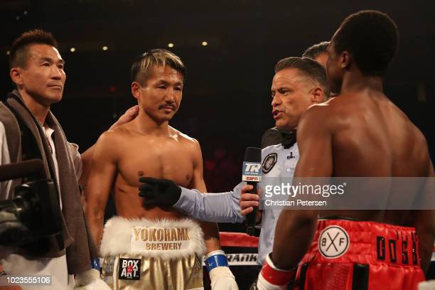 Hidenori Otake of Japan faces off against Isaac Dogboe of Ghana before the WBO junior featherweight championship bout at Gila River Arena on August...
