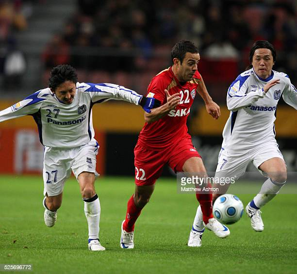 Hideo Hashimoto of Gamba Osaka and Diego of Adelaide United and Yasuhito Endo of Gamba Osaka