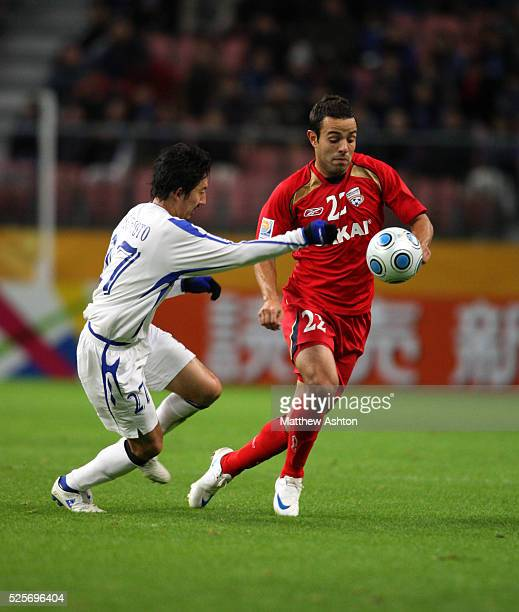 Hideo Hashimoto of Gamba Osaka and Diego of Adelaide United