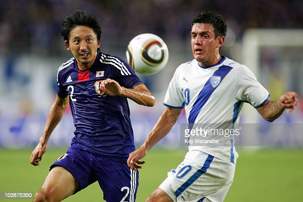 Hideo Hashimoto of Japan and Mario Rodriguez of Guatemala compete for the ball during the international friendly match between Japan and Guatemala at...