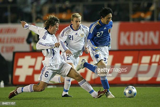 Hideo Hashimoto of Japan controls the ball against Jussi Kujala and Kari Arkivuo of Finland during the Kirin Challenge Cup 2009 match between Japan...