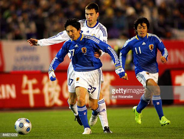 Hideo Hashimoto of Japan escapes the challenge of a Finnish player during the Kirin Challenge Cup 2009 match between Japan and Finland at the...