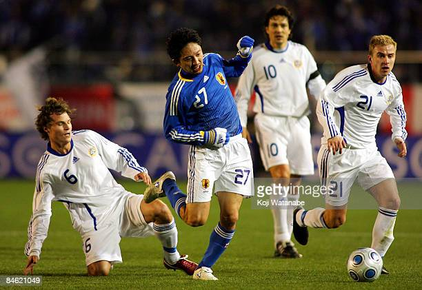 Hideo Hashimoto of Japan looks to avoid challenges from Finnish opponents during the Kirin Challenge Cup 2009 match between Japan and Finland at the...