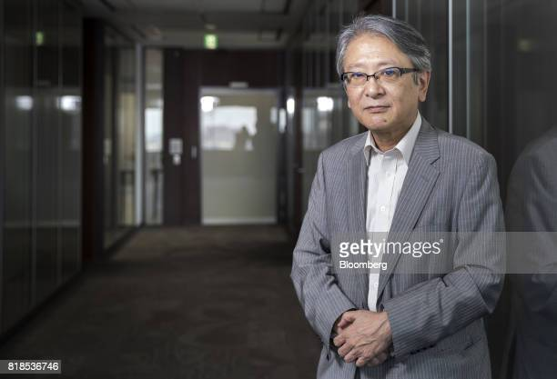 Hideo Hayakawa senior executive fellow at Fujitsu Research Institute poses for a photograph after an interview in Tokyo Japan on Friday July 14 2017...