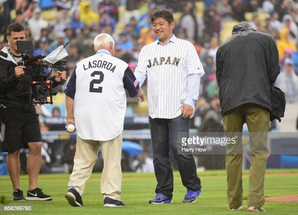 Hideo Nomo and Tommy Lasorda , former MLB players, are seen on the mound for the ceremonial first pitch before team United States takes on team Japan...