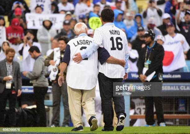 Hideo Nomo and Tommy Lasorda , former MLB players, walk off the mound after throwing out the ceremonial first pitch before team United States takes...
